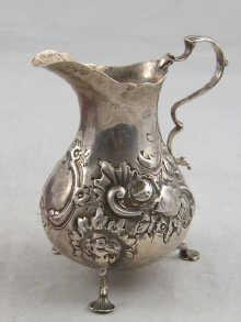 A Victorian silver cream jug with embossed decoration, hallmarked London 1861