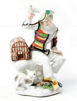 GERMAN PORCELAIN FIGURE OF HARLEQUIN