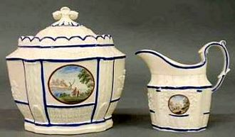 Hard paste sugar bowl and creamer with Chinese landscape decoration