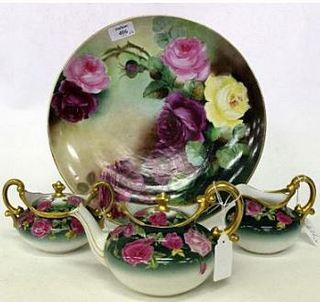 LIMOGES FRANCE PORCELAIN CHARGER with a hand painted rose decoration signed
