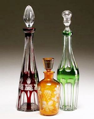 Bohemian cut-to-clear glass decanters with geometric decoration
