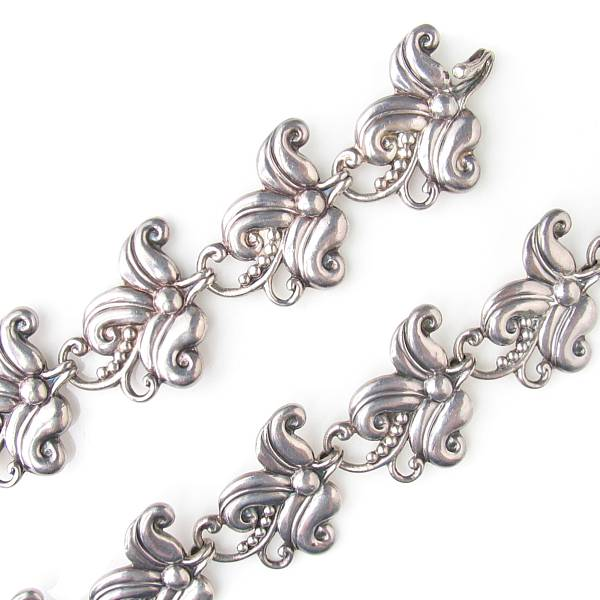 A silver Mexican floral link belt and matching