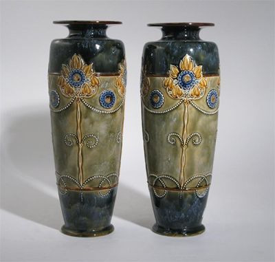 A pair of Royal Doulton stoneware vases tall
