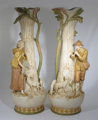 A large pair of Royal Dux vases each modelled