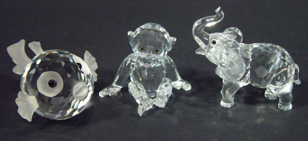 Three boxed Swarovski crystal animals - a