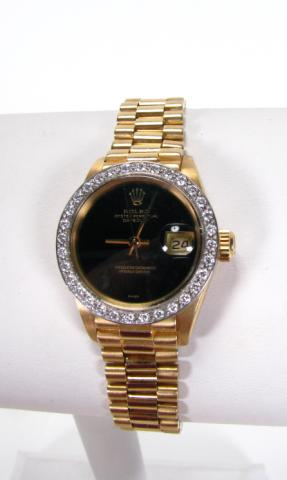 Lady's 18K yellow gold Rolex Oyster Perpetual