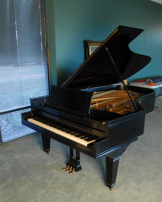 A Chickering & Sons Grand Piano,