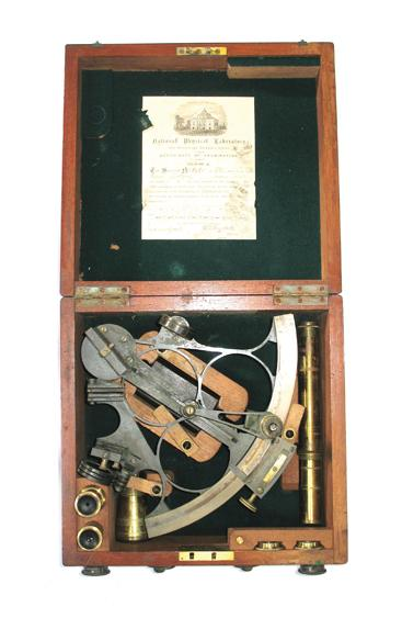 A SEXTANT IN A FITTED CASE with accessories,