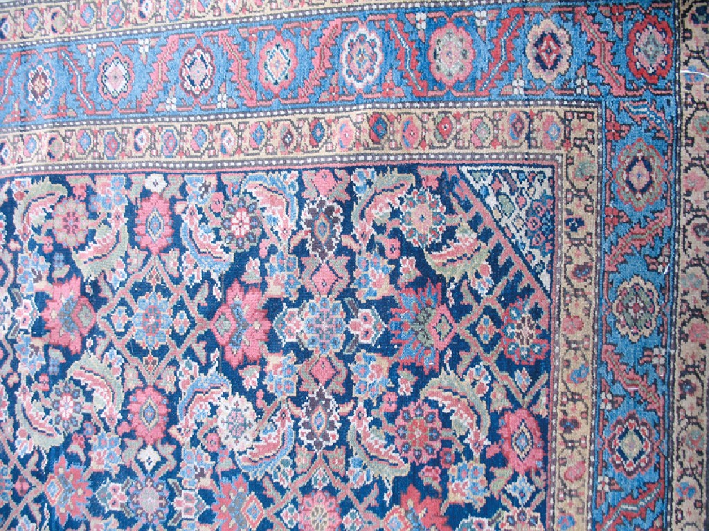 A NORTH WEST PERSIAN RUG, the central dark