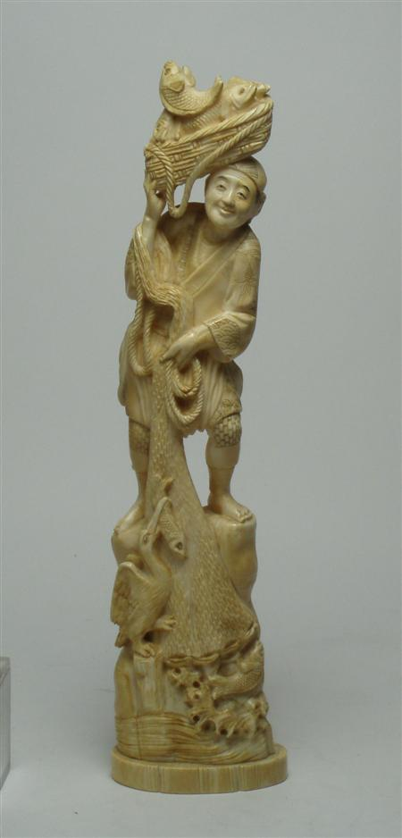 A Japanese ivory figure of a fisherman
