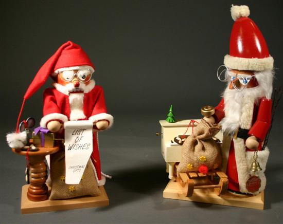 Two Steinbach musical Santa Claus nutcrackers.