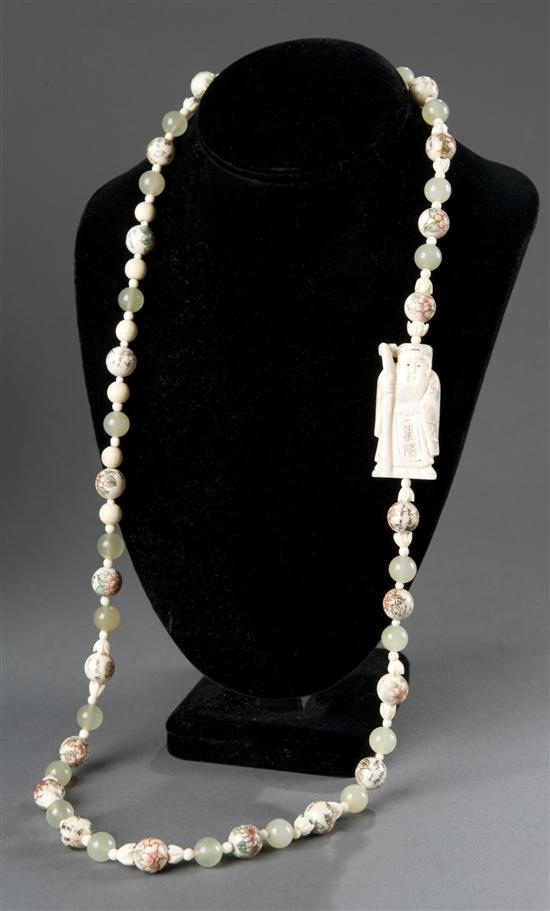 Chinese ivory and serpentine necklace.