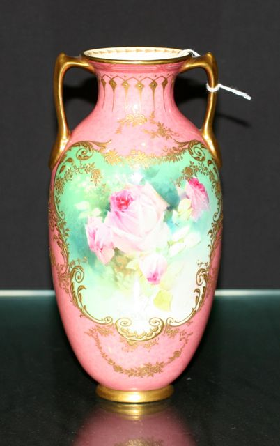 A Royal Doulton twin handled vase, painted