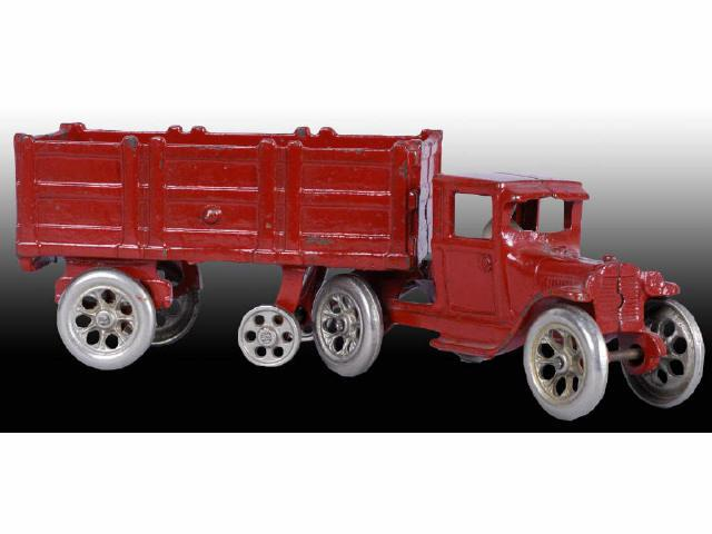 Cast Iron Red Arcade Tractor Trailer Toy.