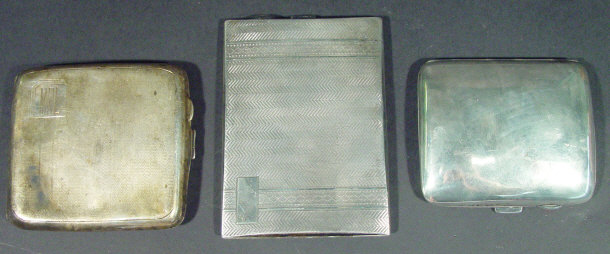 Three silver cigarette cases, two with engine