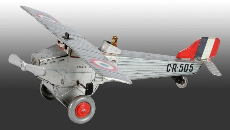 Tin CR-505 Airplane Wind-Up Toy. Description