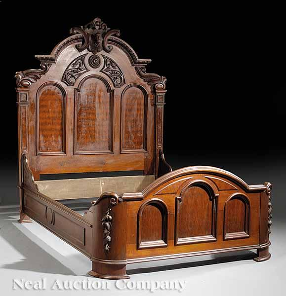 An American Renaissance Carved Walnut Bedstead,
