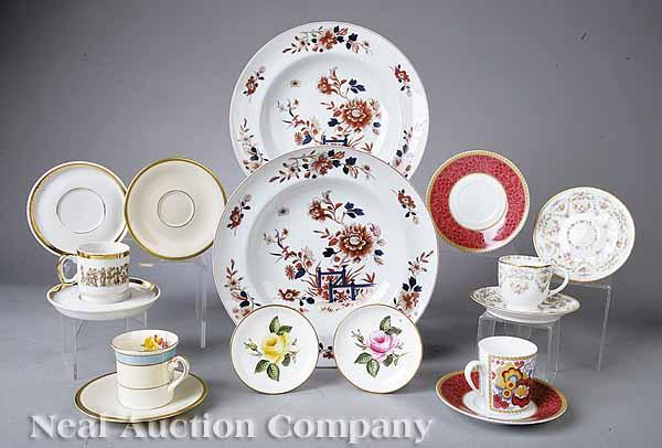 A Group of Porcelain Demitasse Cups and Saucers,