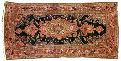 Hand woven Persian rug, central medallion