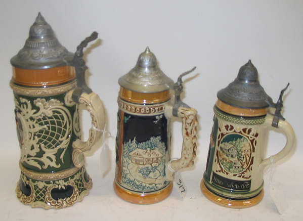 A GROUP OF THREE GERMAN GLAZED POTTERY BEER