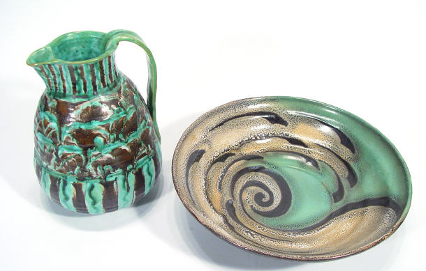 Studio pottery jug with green and brown decoration