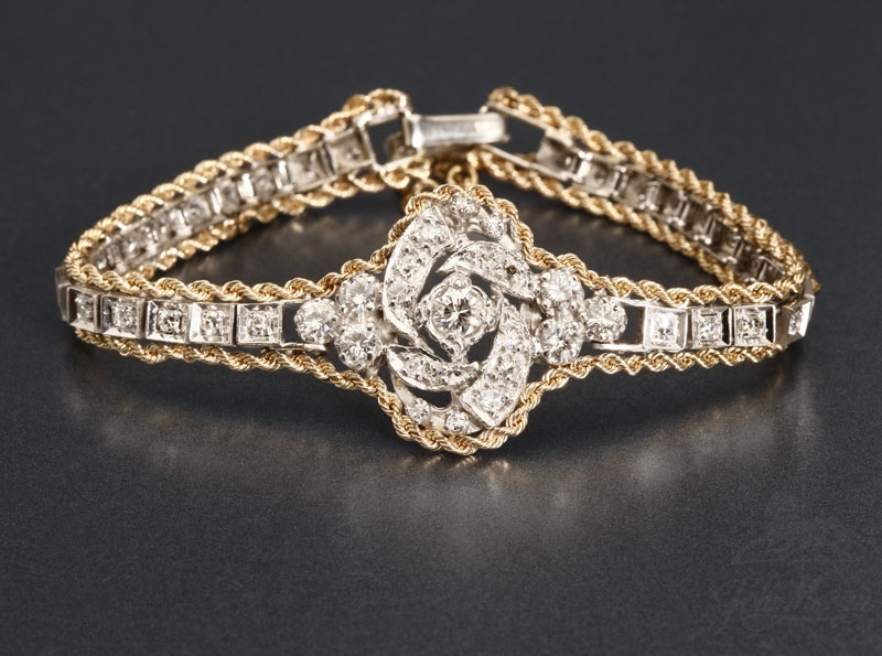 A gold and diamond bracelet. A gold and diamond