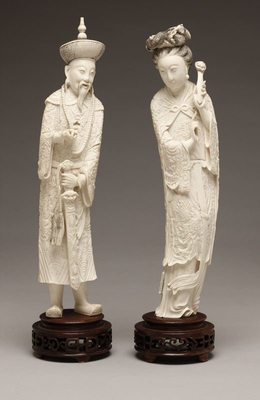 A pair of Chinese carved ivory figures, man