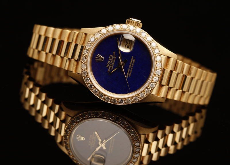 A ladies' Rolex President 18K yellow gold