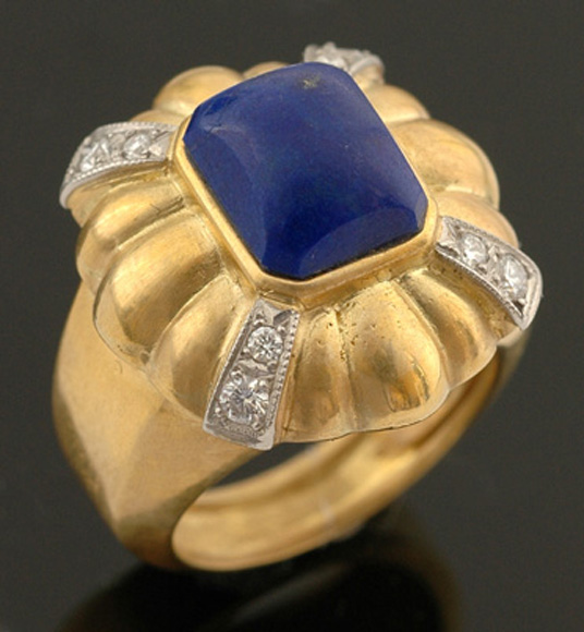 A lapis lazuli and diamond dress ring Centrally