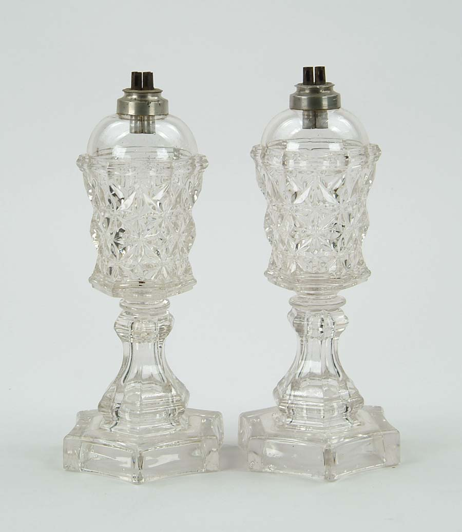 PAIR OF SANDWICH GLASS WHALE OIL LAMPS. In