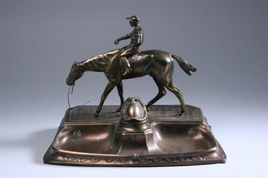 ARTS AND CRAFTS PATINATED METAL FIGURAL INKSTAND.