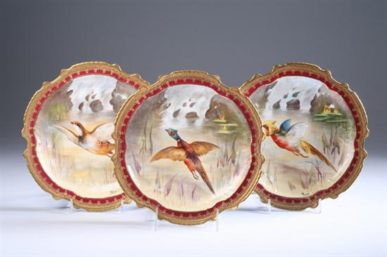 13 LIMOGES HAND-PAINTED PORCELAIN GAME PLATES.