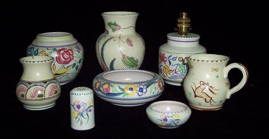 A Poole Pottery vase painted flowers and