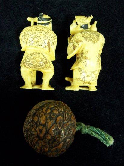 A pair of Japanese carved ivory figures,