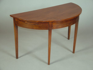 A mahogany demi-lune side table, 19th century,