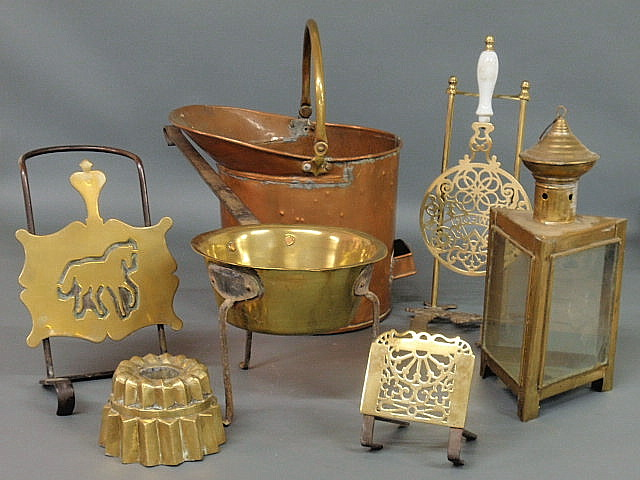 Seven pieces of metalware- copper & tin posnet
