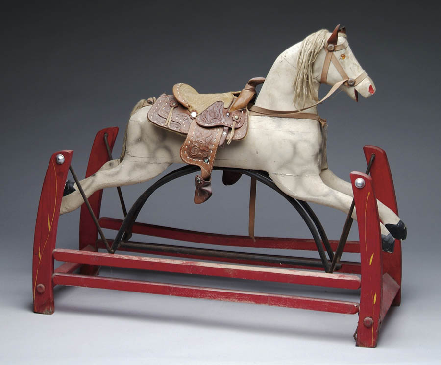 CHILD'S ROCKING HORSE ON STAND. The red