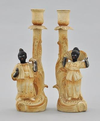 A Pair of Blackamoor Nodder Bisque Candlesticks