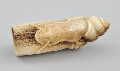 A Carved Antler Netsuke Depicting a Snail