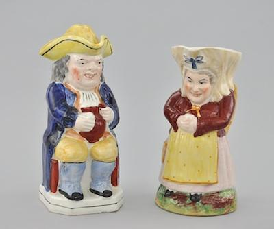 A Pair of Staffordshire Toby Jugs The first