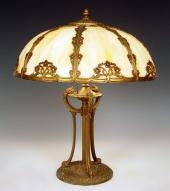 32dddd456ca5 VINTAGE SLAG GLASS TABLE LAMP  8 panel dome shade with caramel slag glass  under Art Nouveau floral design filigree metal. Bronzed finish with hint of  red to ...