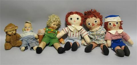 GROUP OF SIX DOLLS Including two Raggedy
