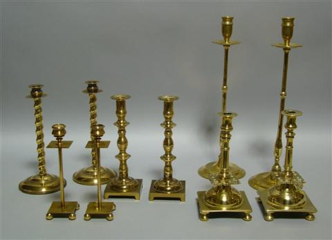 FIVE PAIRS OF BRASS CANDLESTICKS The first
