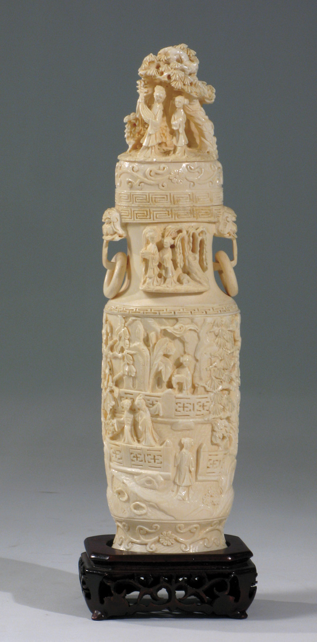 AN ASIAN IVORY CARVED COVERED URN. The cylindrical