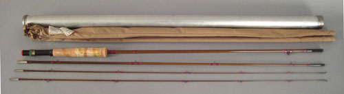 Three fishing rods to include a Heddon Pal