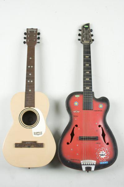 Price guide for Two Vintage Plastic Guitars, the first an