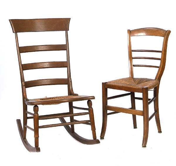 A group of two mixed wood chairs