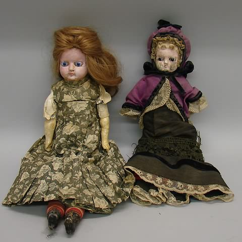"Pair of papier mache dolls. 14"" Has black"