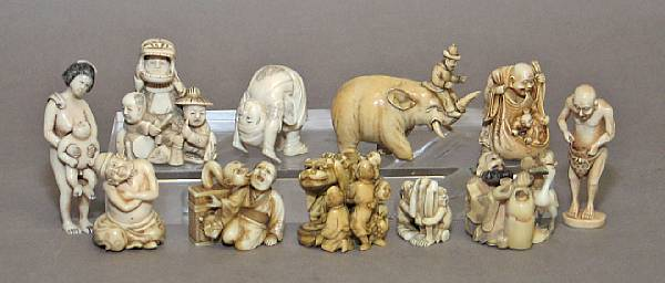 Twelve small ivory figural carvings