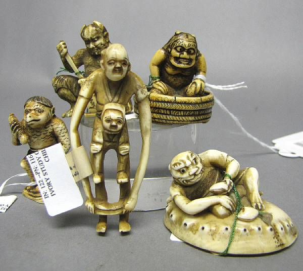 A group of four ivory netsuke